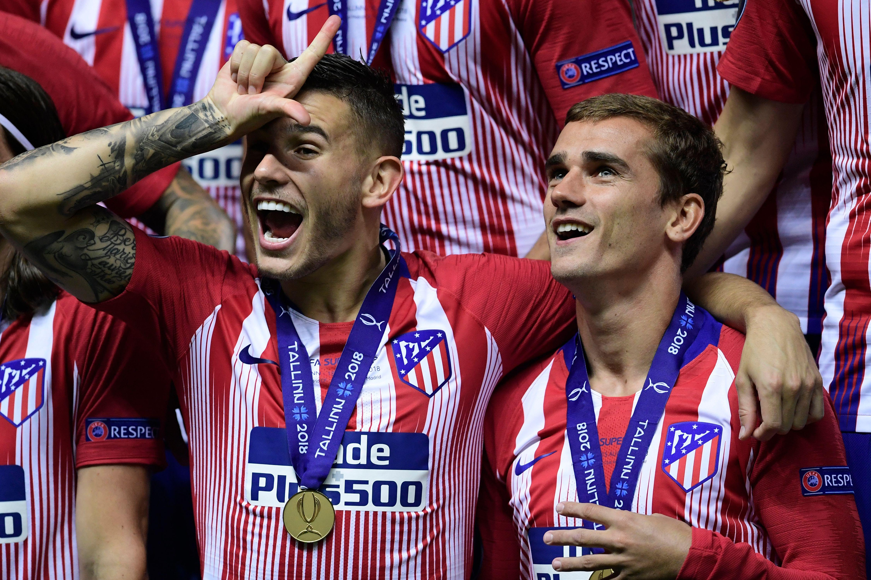 Lucas Hernandez celebrates winning the Europa League with team-mate Antoine Griezmann.